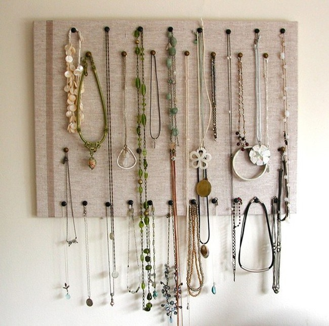 15. Push pins + cork board will organize your necklaces