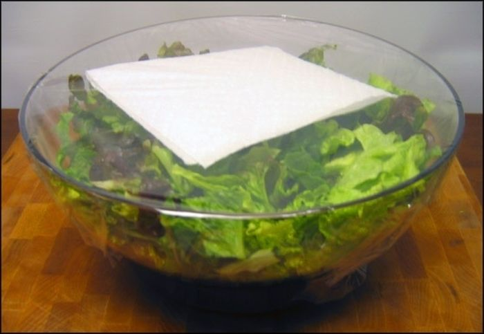 14. Paper towel keeps the salad fresh after slicing it up