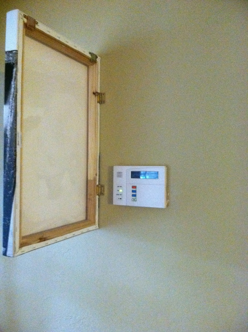2. Hinged Painting to Cover That Ugly looking Thermostat