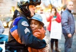 24. Police officer hugs a 12 year old boy following a demonstration for Michael Brown