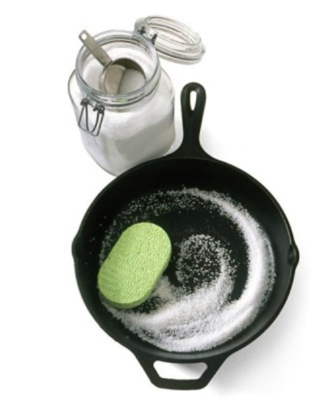 7. Remove the grise and residue from the cast aron skillet with sea salt, water and sponge