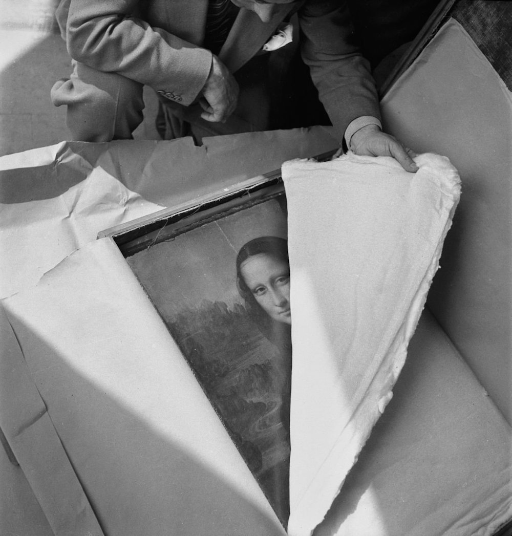 The Mona Lisa being unpacked after spending WWII in hiding, 1945